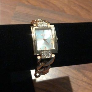Women's faux gold and diamond watch
